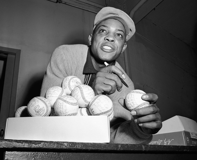 The Giants centerfielder autographs baseballs in the Giants dressing room after a game with Milwaukee was rained out in September 1956. During that season, Mays hit .296 with 36 homers. He also led the league with 40 stolen bases.
