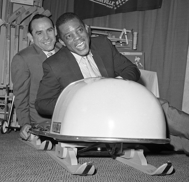 Mays and Yankees legend (and then Mets coach) Yogi Berra try out a new bobsled at a sporting goods fair at the Hotel New Yorker in 1966.