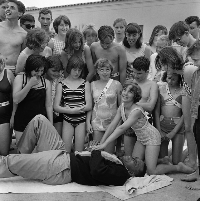 Mays takes part in a demonstration at the Red Cross Volunteer Swim Aide School in 1964. He helped show children the proper technique for CPR.