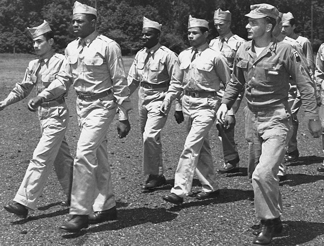 Mays marches during a drill at Camp Kilmer, N.J., in June 1952 as he prepares to be shipped to his basic training site. After winning the Rookie of the Year award in 1951, Mays was drafted into the army and missed most of the 1952 season and all of 1953.