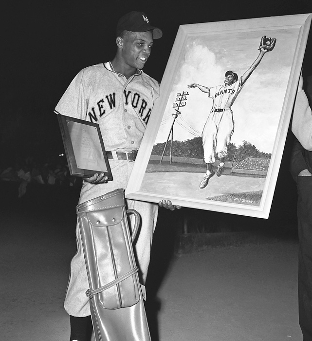 Mays shows some of the gifts he received from fans in Trenton, N.J., before a game there. After signing with the Giants, Mays was assigned to their Class-B minor league affiliate in Trenton. He hit .353 in his time there.
