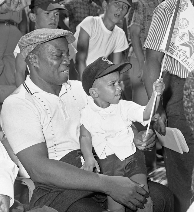 The legendary baseball player's father, Willie Mays, Sr., holds the ballplayer's adopted son, Michael Mays, at the 1961 All-Star game. Mays was playing in his seventh of 20 straight All-Star games that year.