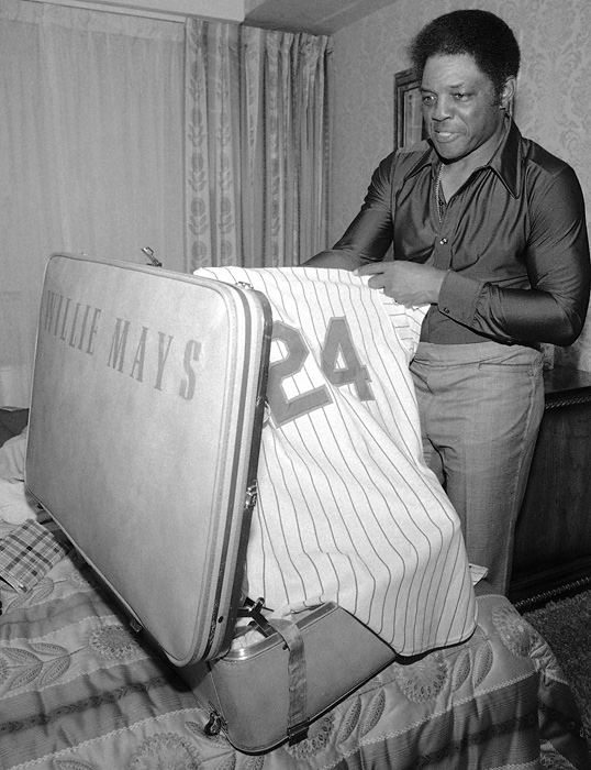 Mays packs for spring training in his apartment in Riverdale, N.Y., in February 1977. After retiring in 1973, Mays worked for the Mets as a hitting instructor.
