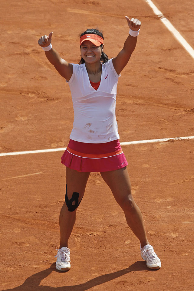 Li Na celebrates her first Grand Slam title.