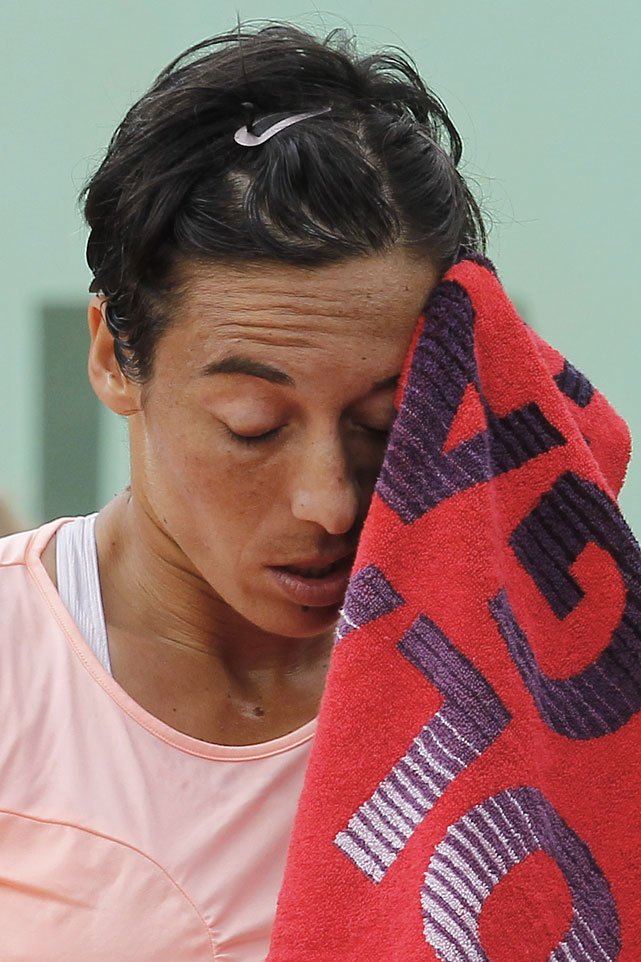 Francesca Schiavone wipes her face during Saturday's match.