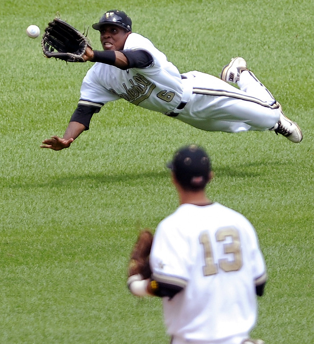 Vanderbilt left fielder Tony Kemp, top, makes a diving catch on Levi Michael's sinking liner in the fourth inning. Kemp helped the Tar Heels strand 16 runners.