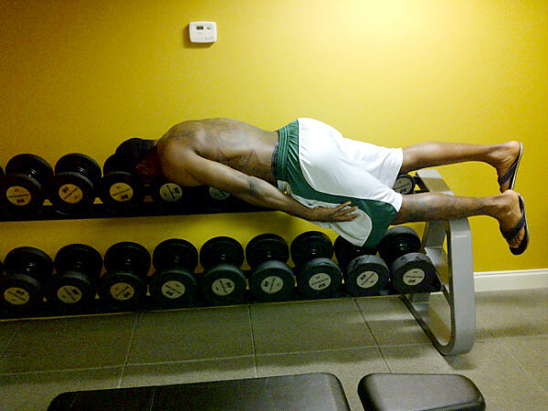 Gilbert Arenas on a rack of weights.