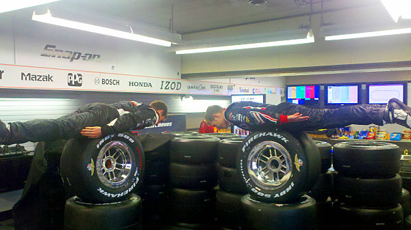 Indy drivers Will Power and Ryan Briscoe fittingly plank on tires.