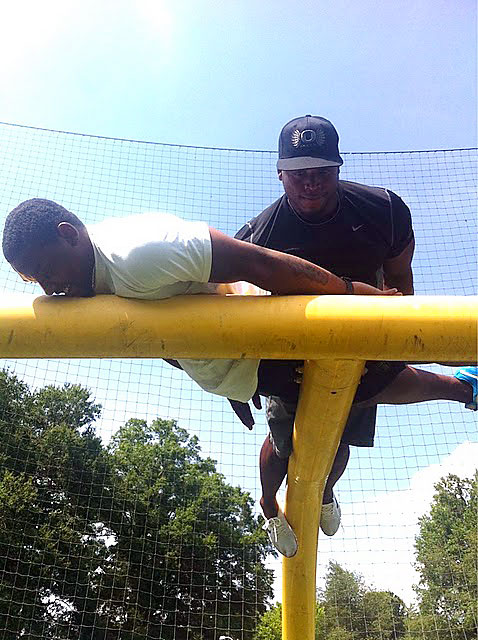 Carolina Panthers' running backs Jonathan Stewart and Tyrell Sutton are planking during the lockout.