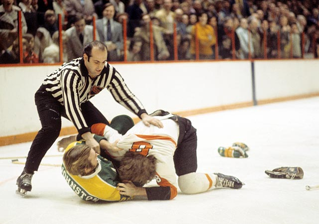 "No one personified the hard-hitting Flyers of the 1970s more than Dave ""The Hammer"" Schultz. He set a record for penalty minutes in a season with 348 in 1973-74, only to top it a year later with 472. Philadelphia won the Stanley Cup in each of those seasons behind intimidating defense and the superb goaltending of Bernie Parent."