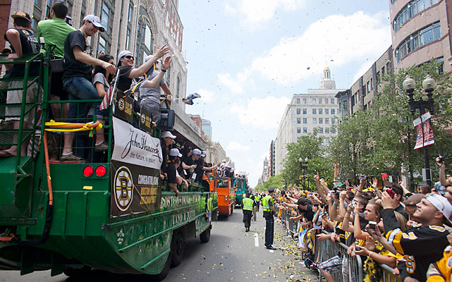 Boston Duck Boats, used for every Boston championship parade, make their way down Boylston Street.