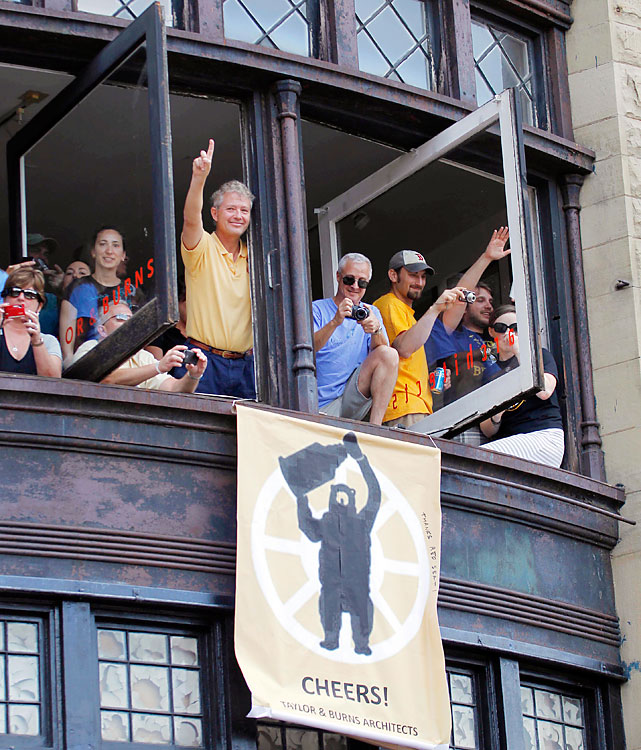 Fans even showed their appreciation from the bordering buildings along the parade route.