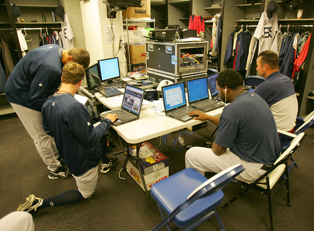 Jonathan Papelbon, Tim Wakefield and Ortiz get their technology on inside the visitor's clubhouse of the O.co Coliseum in Oakland.