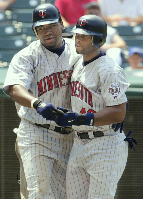 Torii Hunter congratulates David Ortiz after Ortiz slapped a homer for the Minnesota Twins in 2002.