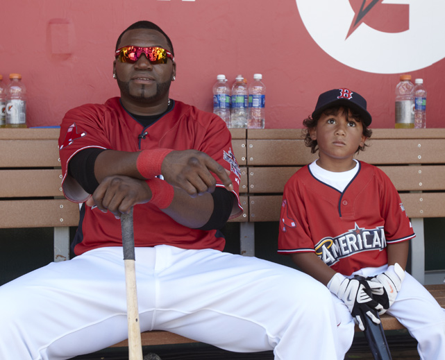 Ortiz sits in the dugout with his son, D'Angelo, before the 2010 MLB All-Star Game. Ortiz won the Home Run Derby during that weekend.
