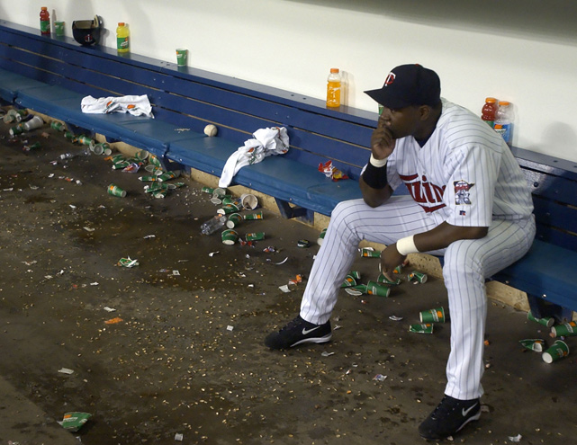 Ortiz sits in the Minnesota dugout after the Twins lost Game 3 of the 2002 American League Divisional Series to the A's. The Twins would go on to make a comeback and defeat Oakland in five games, but would promptly fall 4-1 to the Angels in what would turn out to be Ortiz's last year in Minnesota.