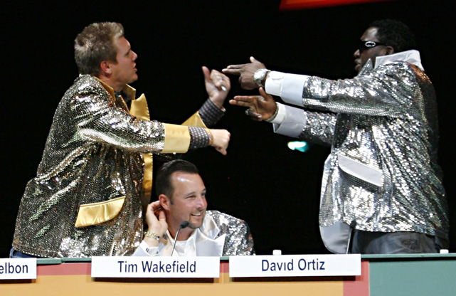 Jonathan Papelbon and David Ortiz argue in front of Tim Wakefield during a game show spoof at the Red Sox Foundation Welcome Home Dinner.