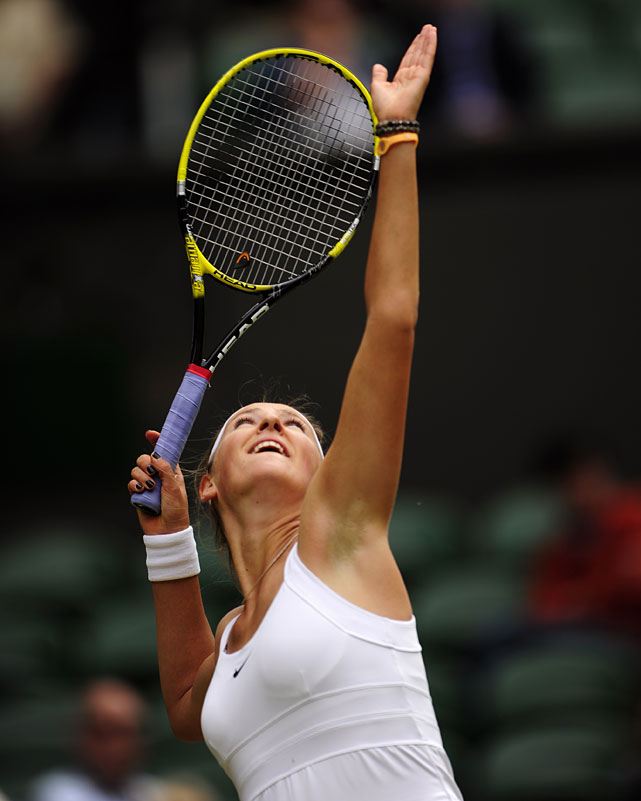 Victoria Azarenka of Belaurs serves to Slovakia's Daniela Hantuchova during their third-round match.