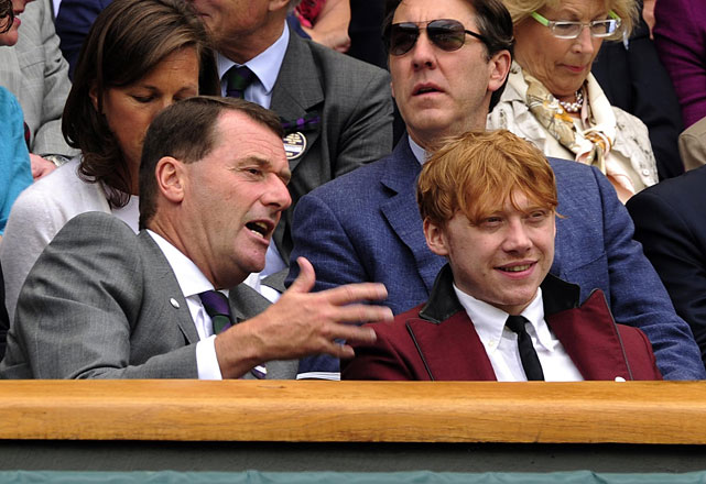 Actor Rupert Grint (right) chats with All England Club vice chairman Philip Brook in the Royal Box on Centre Court.