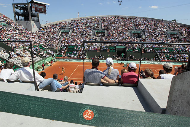 Maria Sharapova returns the ball to Andrea Petkovic at Court Suzanne Lenglen.