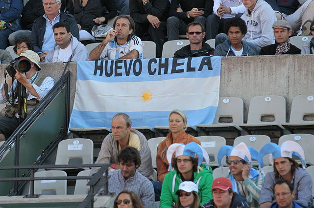 Argentine supporters display a national flag during the quarterfinal match between Argentina's Juan-Ignacio Chela and Great Britain's Andy Murray.
