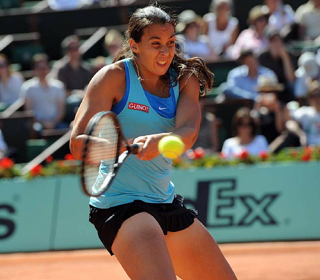 Marion Bartoli hits a return to Francesca Schiavone.
