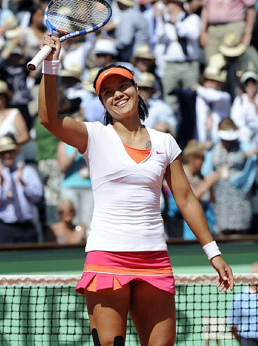 Li Na celebrates her semifinal victory. The 29-year-old will be the first Chinese woman to play in a French Open final.
