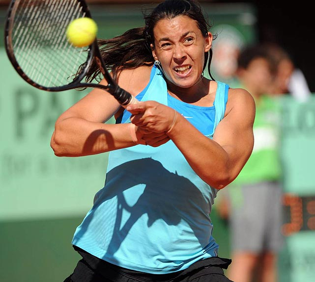 Marion Bartoli returns the ball to Francesca Schiavone. Bartoli led 2-0 in the second set before Schiavone rallied to for control of the match.