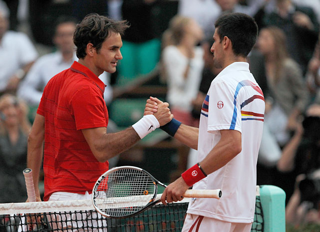 Roger Federer shakes hands with Novak Djokovic following their semifinal match.