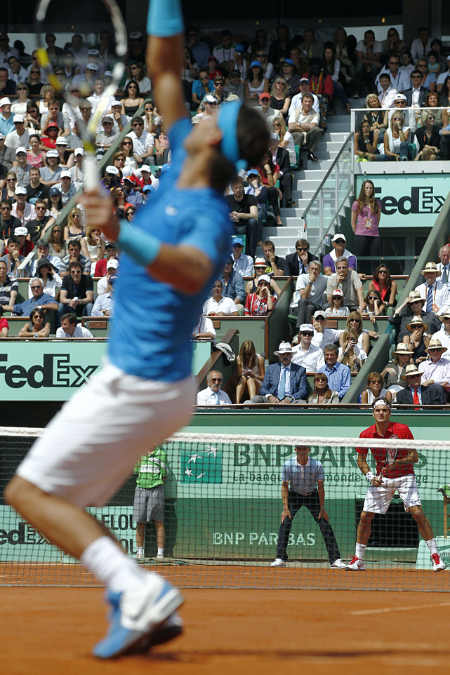Nadal serves to Federer in the first set of Sunday's match.