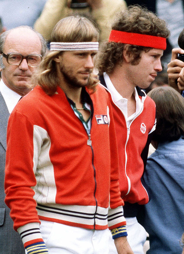 Borg and McEnroe await the trophy ceremony after their marathon 1980 Wimbledon final.