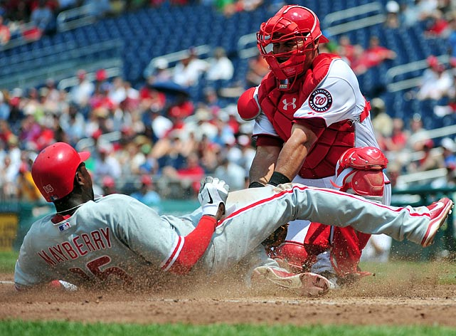 Nationals catcher Wilson Ramos and Phillies outfielder Jon Mayberry avoid a  collision during the Nationals' 2-1 victory on June 1.