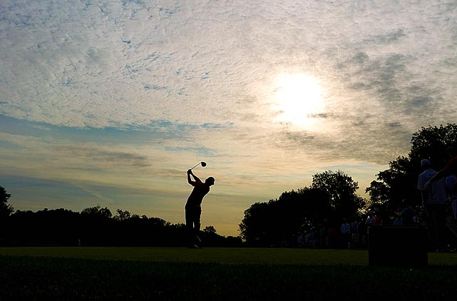 An epic shot shows Rory McIlroy teeing off at the first hole of the second round of the Memorial Tournament in Dublin, Ohio, on June 3.