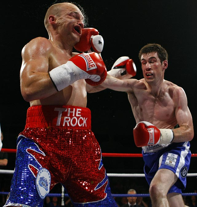 "Gavin ""The Rock"" Rees takes a punch from Andy Murray during their European lightweight title bout at Motorpoint Arena in Cardiff, Wales. Rees would go on to win and hand Murray his first defeat in 25 fights as a professional."