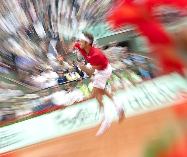 Sports Illustrated  photographer Heinz Kluetmeier captured this psychedelic shot of Roger Federer serving to Gael Monfils during the French Open quarterfinals on May 31. Federer would go on to win 6-4, 6-3, 7-6 to advance to the semifinals.