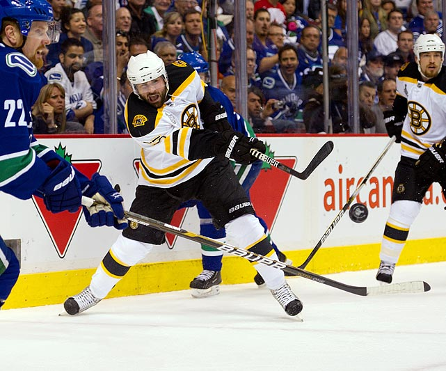 Boston Bruins defenseman Johnny Boychuk blasts a puck from behind the goal line during the Bruins' 1-0 loss to the Vancouver Canucks in Game 1 of the Stanley Cup finals.