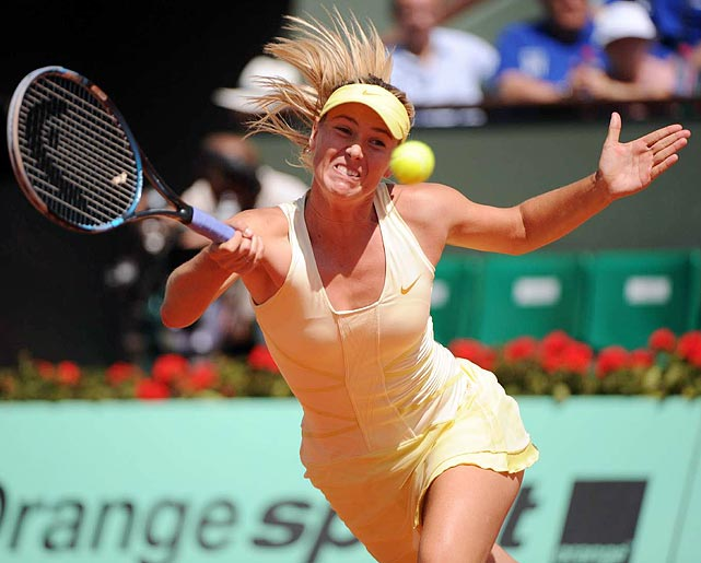 Maria Sharapova reaches for a ball during her French Open semifinals loss to Li Na, the eventual champion.