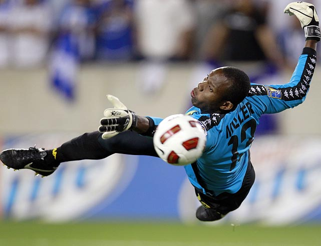 Jamaican goalkeeper Dwayne Miller deflects a free kick from Honduras defender Victor Bernardez during Jamaica's 1-0 victory over Honduras in the Gold Cup group play stage on June 13.
