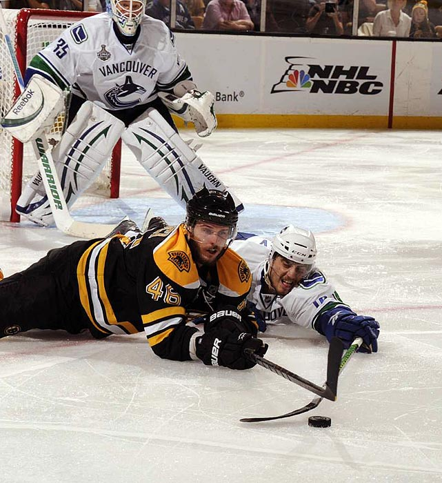 The Bruins and Canucks literally took their battle to the ice as Bruins center David Krejci (left) and Canucks defenseman Chris Tanev jockeyed for a puck during the Bruins' 5-2 win in Game 6 of the Stanley Cup finals.