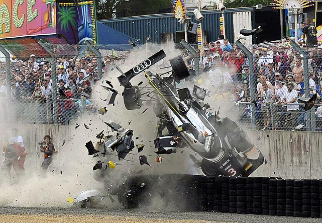Scottish driver Allan McNish's car shatters into hundreds of fragments following a crash at the 24-hour Le Mans endurance race on June 11. McNish was not seriously injured in the accident.