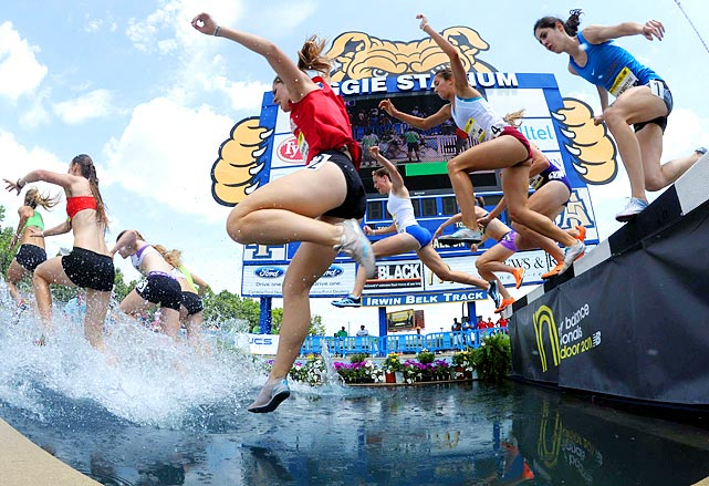 A brave photographer captures the water jump during the girls steeplechase at the New Balance nationals on June 18.