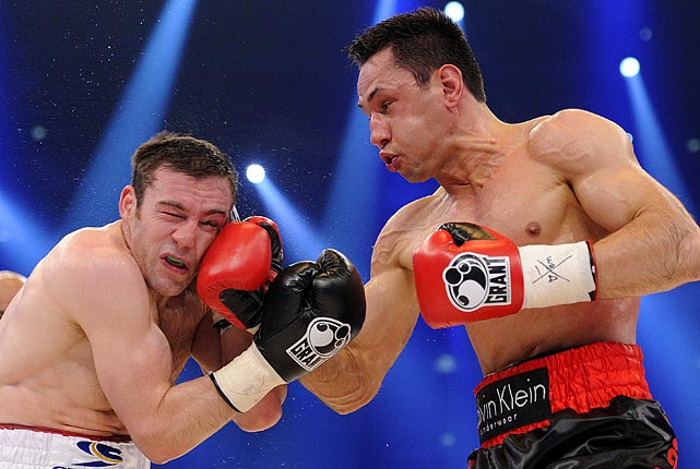 Defending WBA middleweight world champion Felix Sturm lands a winning blow to Matthew Macklin during their title fight in Germany on June 25.