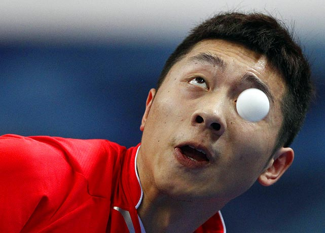 China's Xu Xin keeps his eye on the prize against Germany's Timo Boll during their table tennis game at the Volkswagen 2011 China vs. World Team Challenge event in Shanghai on June 25.