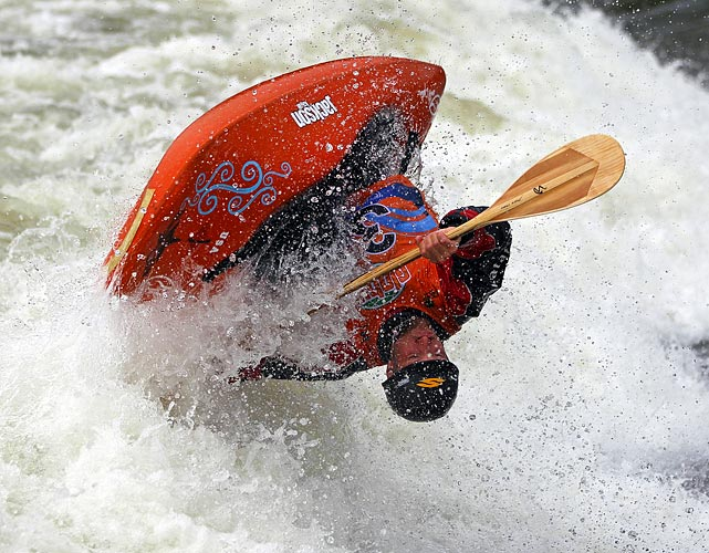 Dustin Urban of the U.S. flips during the quarterfinals at the ICF Freestyle World Championships in Plattling, Germany.