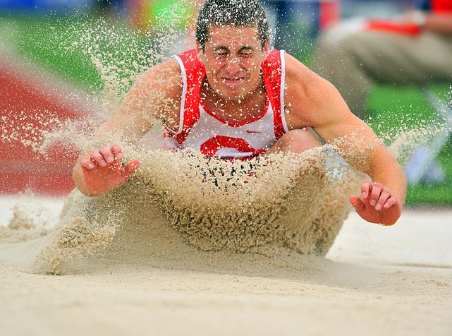 Cornell's Nick Huber lands  during the long jump portion of the decathlon. He finished the event in 11th place.