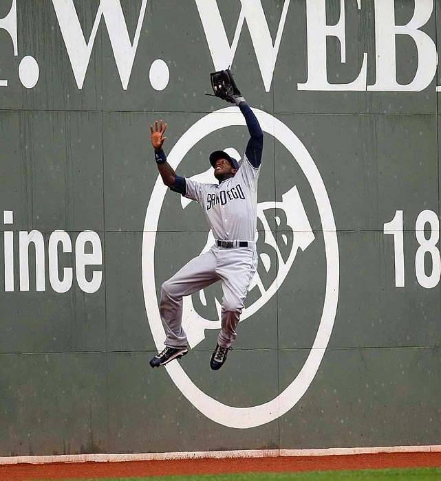 San Diego center fielder Cameron Maybin rises to the occasion at Fenway Park on June 22, robbing a Boston hit during the Padres' 5-1 win.