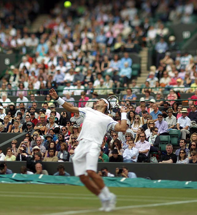 Two-time Wimbledon champion and No. 1 player Rafael Nadal serves at the All England Club on June 25. Nadal defeated Gilles Muller in three sets to advance to the fourth round.