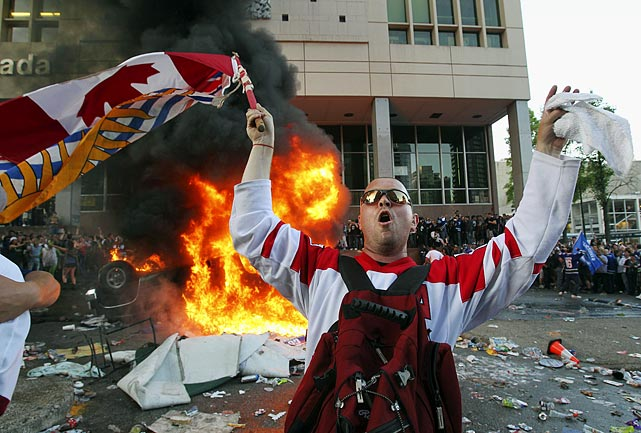 The debate of violence in hockey took new meaning in Vancouver, B.C., as fans turned their frustration over losing Game 7 of the Stanley Cup finals into a riot-filled evening on the city's streets Wednesday night, complete with overturning and burning police vehicles and engaging in widespread looting.