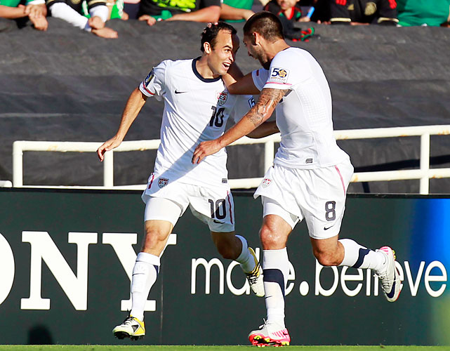 Landon Donovan (left) made it 2-0 in the 23rd minute, scoring off a pass from Clint Dempsey (right) on a beautiful build up from Adu.