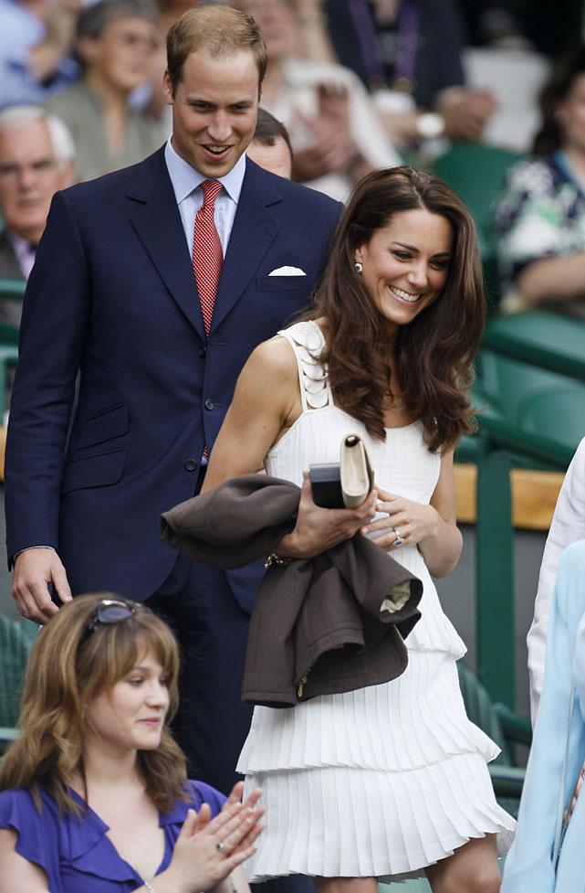 Britain's Duke and Duchess of Cambridge were greeted by a standing ovation while taking their seats at Centre Court prior to the start of Andy Murray's fourth-round match with Richard Gasquet.